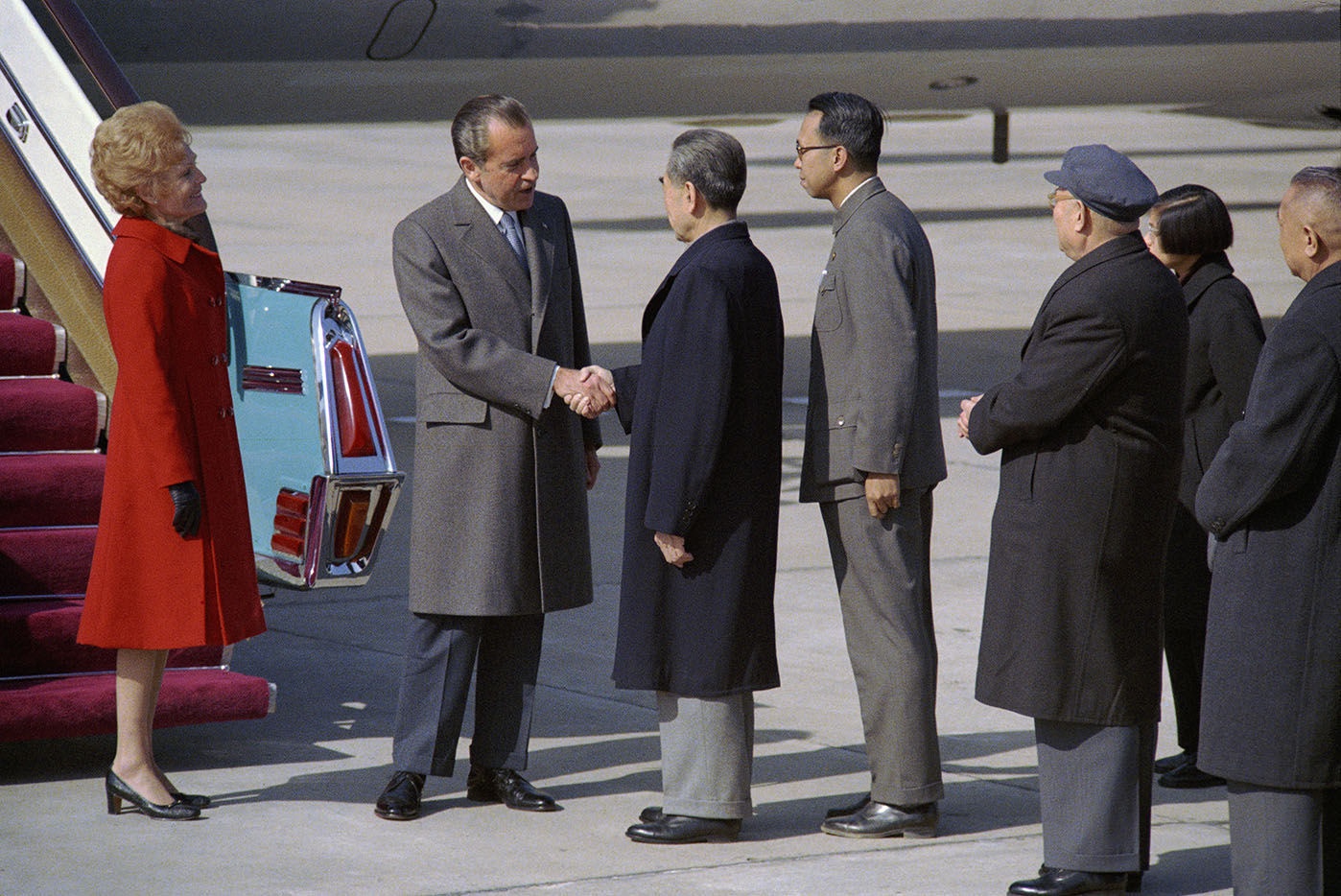 President Nixon shakes hands with Premier Chou En-lai of the People's Republic of China, as Mrs. Nixon looks on