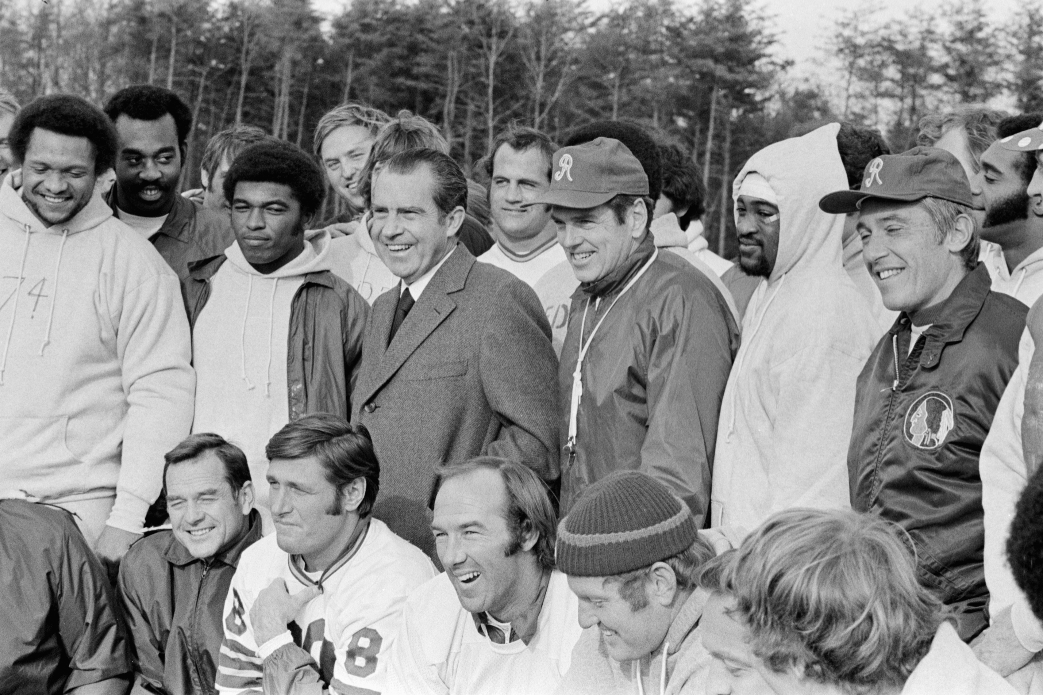 November 23, 1971. President Nixon with Redskins Coach George Allen, Redskins football players and the coaching staff including quarterbacks Billy Kilmer and Sonny Jurgenson.