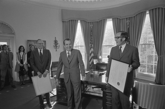 L-R, unidentified family members, Lewis Powell, President Nixon, William Rehnquist